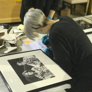 A student works on The Beatles exhibit.
