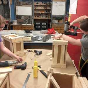 Students in the woodshop working.
