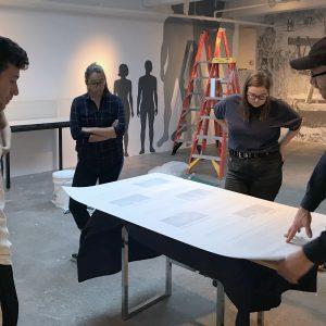 Students installing an exhibit.