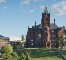 Wideshot of Crouse College in the summer.